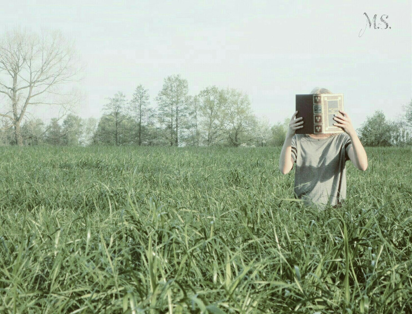 Books are a great place to hide behind if you don't want to face the world around you.     #books  #photography  #creativeselfie  #portret   #grass  #nature  #naturephotography  #minimalism